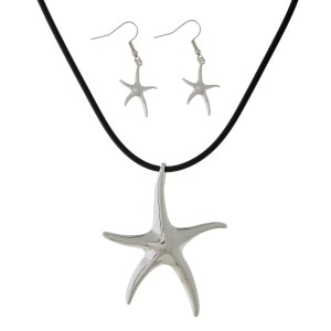 "Black rubber cord necklace set with a silver tone starfish pendant and matching fishhook earrings. Approximately 16"" in length."
