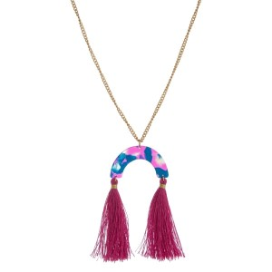 """Gold tone necklace with an acetate pendant and thread tassels. Approximately 30"""" in length."""
