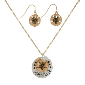 "Gold tone necklace set with a ""beach life"" charm pendant. Approximately 16"" in length."