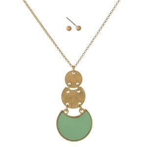 """Dainty gold tone necklace with a faux leather circle pendant and matching earrings. Approximately 16"""" in length."""