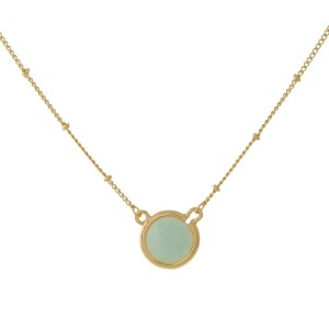 "Dainty gold tone necklace with a circle, natural stone pendant. Approximately 16"" in length."