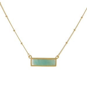 "Dainty gold tone necklace with a rectangle, natural stone pendant. Approximately 16"" in length."
