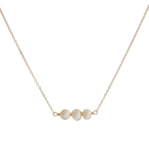 """Dainty metal necklace with three, wire wrapped, freshwater pearl beads. Approximately 16"""" in length."""