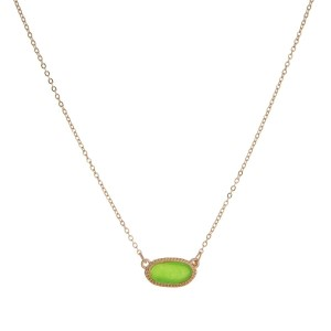 """Dainty gold tone necklace with an oval, faux druzy stone pendant. Approximately 16"""" in length."""