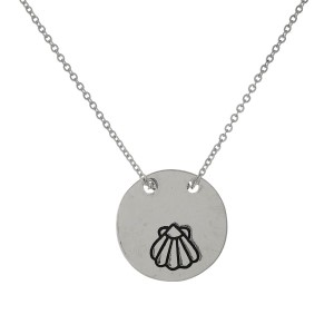 "Dainty necklace with a circle pendant stamped with ""What the shell."" Approximately 16"" in length."