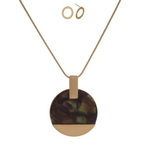 """Short, metal necklace set with an acetate circle pendant ad matching stud earrings. Approximately 18"""" in length."""