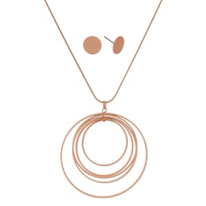 """Long, metal necklace set with a circle pendant and matching stud earrings. Approximately 32"""" in length."""