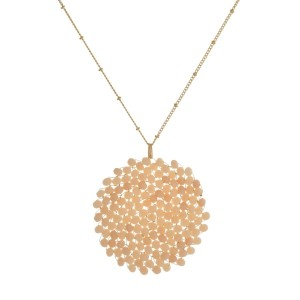 "Gold tone necklace with a beaded, wire-wrapped circle pendant. Approximately 32"" in length."