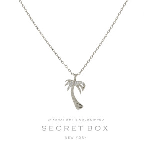 "Secret Box 24 karat white gold over brass, palm tree pendant necklace. Approximately 16"" length."