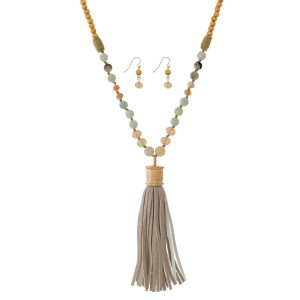 """Long, wooden bead necklace with a faux leather pendant and matching fishhook earrings. Approximately 34"""" in length."""