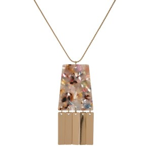 """Gold tone, adjustable necklace with acetate pendant. Approximately 20"""" in length."""