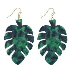 """Gold tone fishhook earrings with an acetate, palm leaf shape. Approximately 2.5"""" in length."""