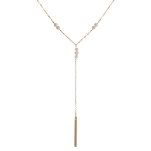 "Dainty, metal Y necklace with pearl accents and bar pendant. Approximately 18"" in length."