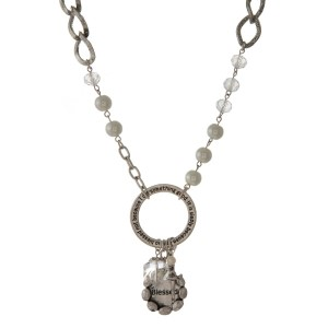 Long necklace with faceted beads, pearl details, and circle pendant stamped with encouraging message.