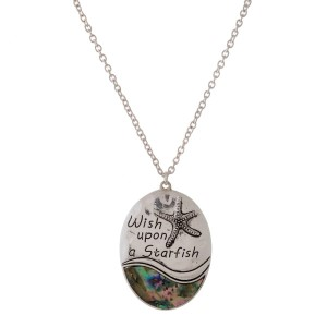 Long silver tone necklace with abalone accent and stamped message.