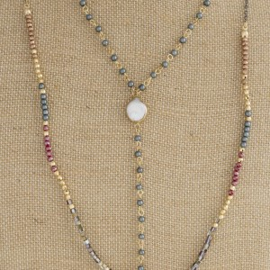 """Dainty layered necklace with pearl detail and faceted beads. Approximately 28-32"""" in length."""
