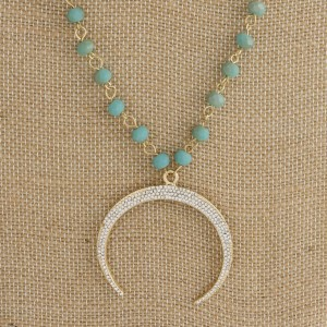"""Long necklace with faceted beads and rhinestone horn pendant. Approximately 34"""" in length."""