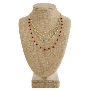 """Gold tone layered necklace with natural stone beads and star details. Approximately 18"""" in length."""