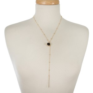 "Dainty, gold tone Y necklace with a druzy stone charm. Approximately 20"" in length."