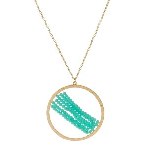 """Long, gold tone necklace with faceted beaded circle pendant. Approximately 30"""""""