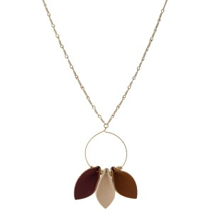 """Gold tone necklace with circle pendant accented with leather. Approximately 32"""" in length."""