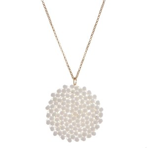 """Long, metal necklace with a beaded, circle shaped pendant. Approximately 32"""" in length."""