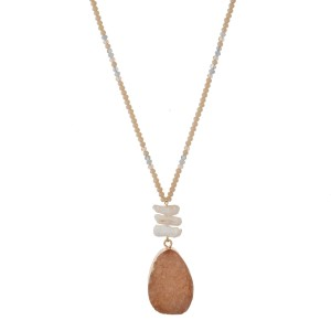 """Gold tone necklace with a half beaded chain, freshwater pearls and a druzy stone pendant. Approximately 32"""" in length."""
