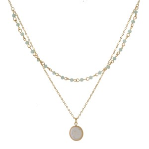 "Dainty, gold tone, two layer necklace with beaded accents and a freshwater pearl bead pendant. Approximately 14"" and 15"" in length."