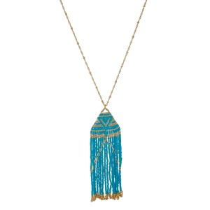 "Gold tone necklace with a beaded tassel pendant. Approximately 32"" in length."
