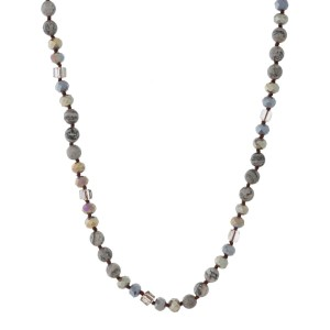 Long beaded necklace with a mix of faceted and natural stone. Approximately 28""
