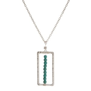 """Long, metal necklace with a rectangle pendant, natural stone accent. Approximately 24"""" in length."""