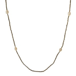 Long necklace with glass beads and peal accents. Approximately 28""