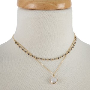 "Dainty necklace with faceted beads and pearl focal. Approximately 18"" in length."