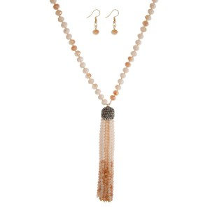 "Long, faceted beaded necklace with beaded tassel and matching fishhook earrings. Approximately 30"" in length."