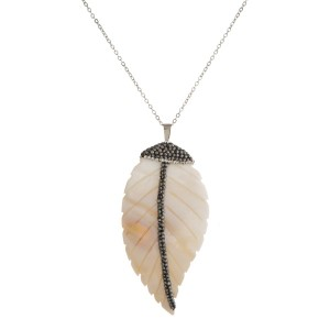 """Silver toned necklace with mother of pearl pendant. Approximately 24"""" in length with a 3"""" pendant."""