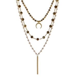 "Gold tone, three layer necklace with natural stones and a horn pendant. Approximately 14"" to 20"" in length."
