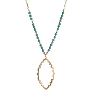 "Gold tone necklace with natural stone beads and Moroccan shaped pendant. Approximately 32"" in length."