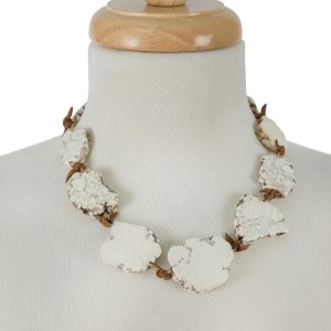 """Brown faux suede necklace with a natural stone nuggets. Approximately 18"""" in length."""