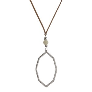 "Suede cord necklace with natural stone and Moroccan shaped pendant. Approximately 32"" in length."