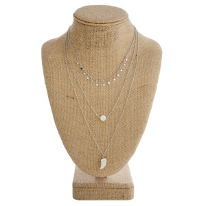 """Layered necklace with star, pearl, and horn charm. Approximately 16""""-22"""" in length."""
