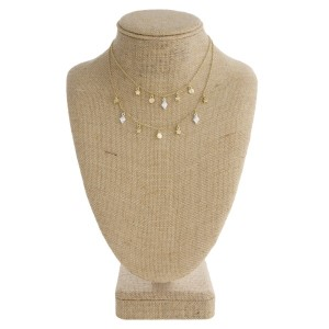 """Layered necklace with dainty charms. Approximately 16"""" in length."""