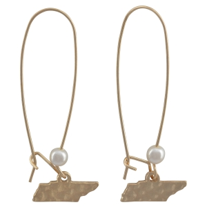 """Matte gold tone fishhook earrings with a hammered state of Tennessee and faux pearl accent. Approximately 1 3/4"""" in length."""