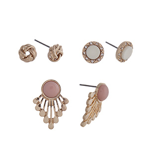 Gold tone three pair earring set with knot studs, ivory stone studs and light pink studs with metal fringe.