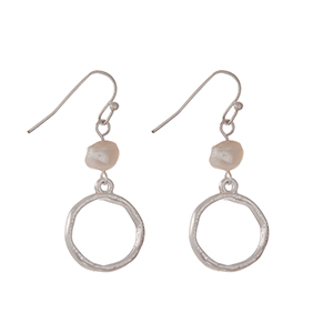 """Silver tone fishhook earrings with a freshwater pearl bead and an open circle shape. Approximately 1"""" in length."""