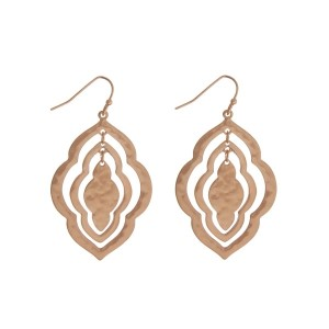 "Matte gold tone fishhook earrings with a hammered texture and a quatrefoil shape. Approximately 2"" in length."
