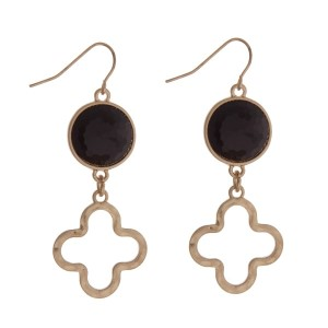"Gold tone fishhook earrings with a black stone and a quatrefoil cutout. Approximately 2"" in length."