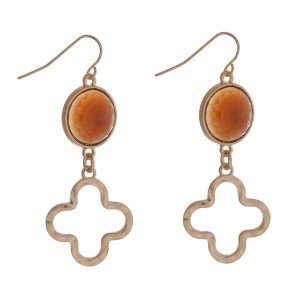"Gold tone fishhook earrings with a brown stone and a quatrefoil cutout. Approximately 2"" in length."