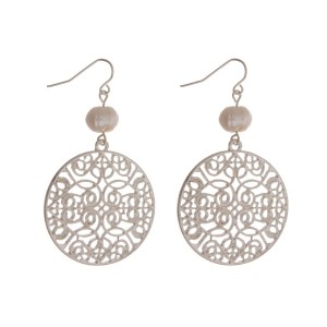 """Silver tone fishhook earrings with a filigree circle shape and a freshwater pearl bead. Approximately 2"""" in length."""