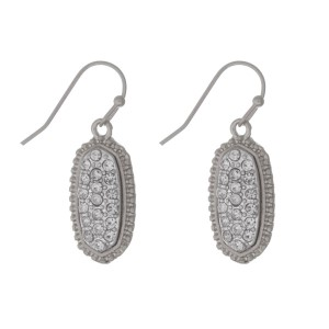 "Silver tone fishhook earrings with a clear rhinestone pave oval. Approximately 1"" in length."