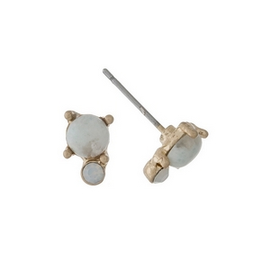 """Dainty gold tone stud earrings with an ivory stone accented by an opal rhinestone. Approximately 1/4"""" in length."""